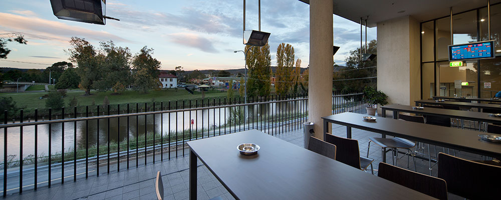 Outdoor terrace with a view of the river
